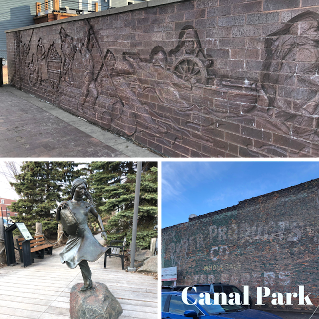 Admiring the sights of Canal Park including sculptures and ghost signs.