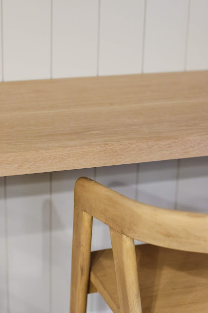 Close up of white oak floating desk