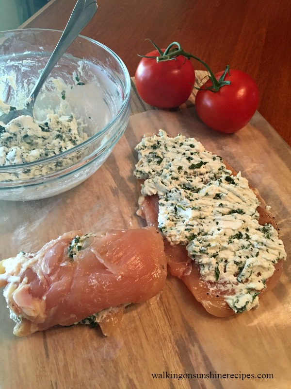 Spread a layer of ricotta cheese and spinach on top of each chicken breast and then gently roll up.