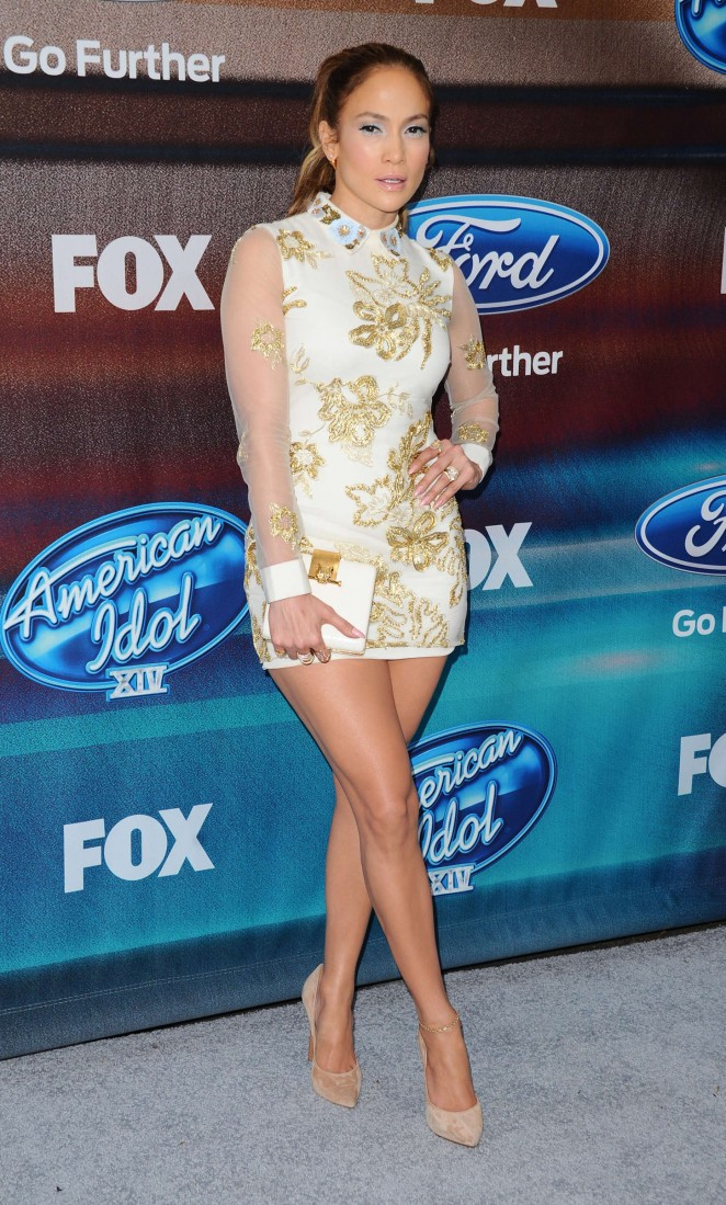 Jennifer Lopez in a gold embellished mini dress at the American Idol XIV Finalist Party in LA