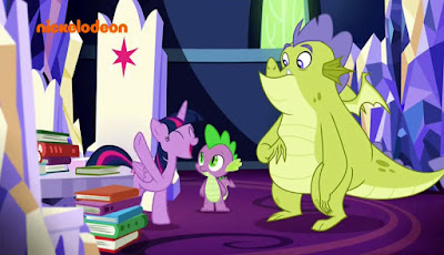 Happy Twilight with Spike and  unsure-looking Sludge in a castle room containing many books