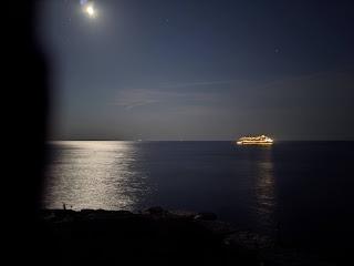 A empty Costa cruise ship seen from San Pietro (Porto Venere) at night