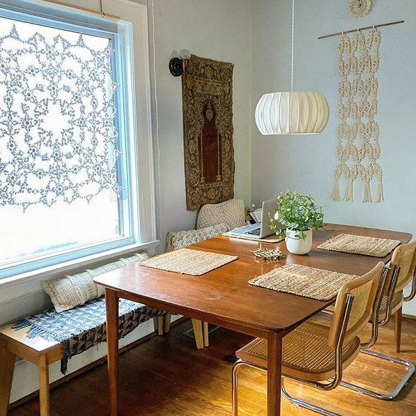 large scale quilled doily on display as a window shade