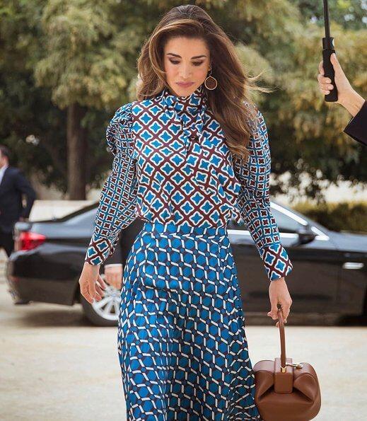 Queen Rania of Jordan wore a new printed satin top and blouse by Zara. 14th Teacher Award and 6th Principal Award