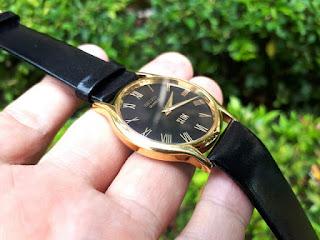 Jam Tangan Seiko Slim Quartz Gold Plated Black Roman Dial SK007