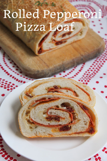 Food Lust People Love: A simple pizza dough is transformed into a rolled pepperoni pizza loaf, with mozzarella cheese and sun-dried tomatoes, freshly baked and ready to slice and serve.