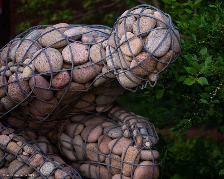 """Portland, Maine USA July 2019 photo by Corey Templeton. One of the """"Rising Cairn"""" artworks by Celeste Roberge, outside of the Portland Museum of Art."""