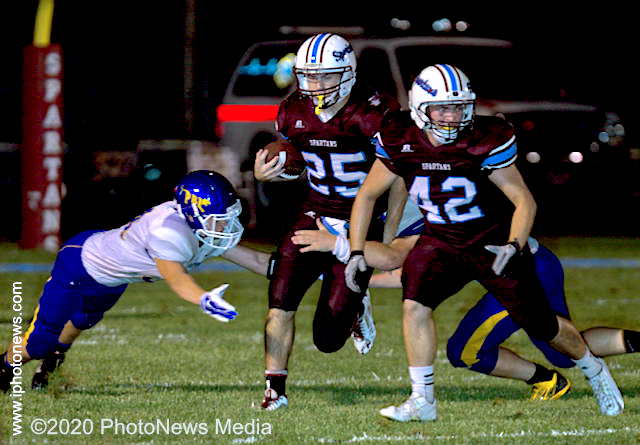 SJO's Connor Janes carries the ball through the PBL defensive line in 2014