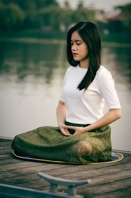 a girl practicing meditation