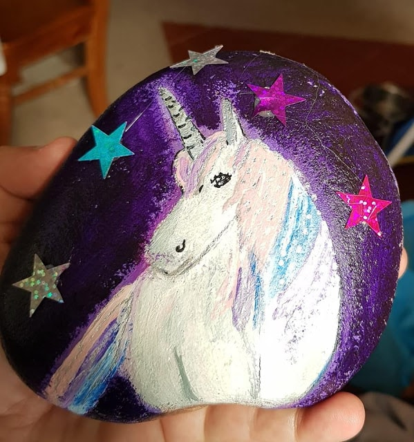 dark and moody unicorn rock painting with star stickers