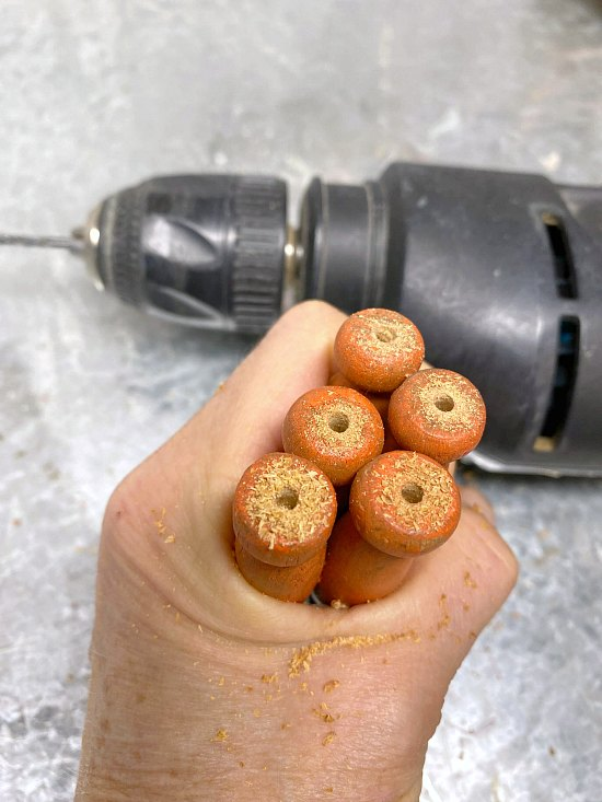 drilled holes in clothespin carrots