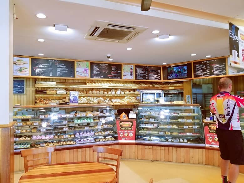 a picture inside the bakery full of pastries