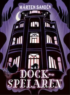 Ett mystiskt hotell på omslaget till boken Dockspelaren.