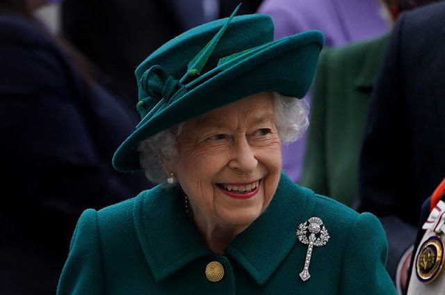 The Queen selected Queen Mary's Diamond Thistle Brooch for her lapel. Prince of Wales and Duchess of Cornwall