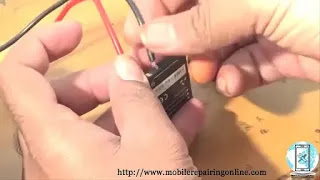 boost cell phone batteries connect the adopter output wire to the battery terminal