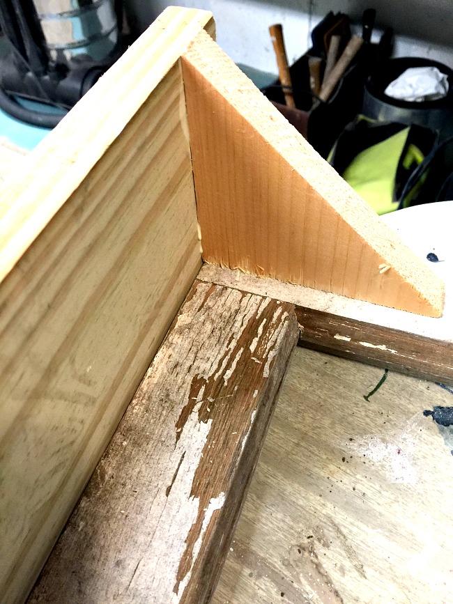 wooden shelf brackets to hold a shelf on a chippy window.