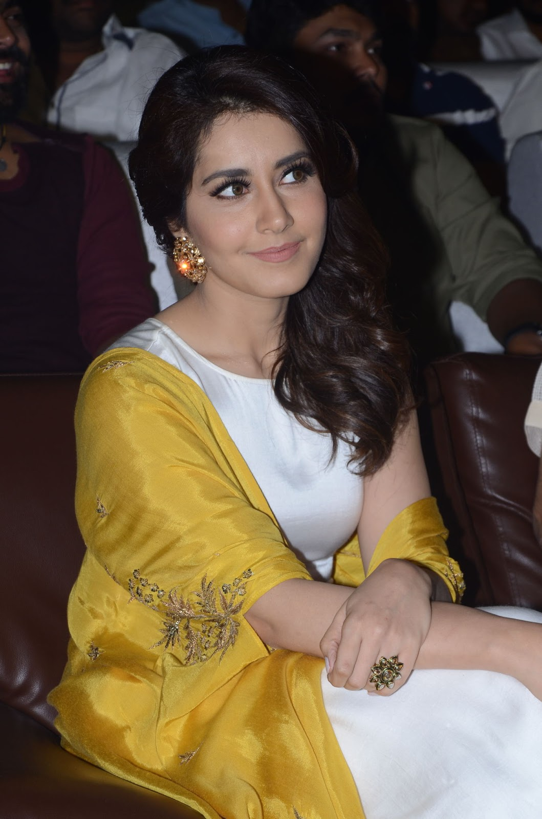Raashi Khanna in a Long Yellow White Dress at Balakrishnudu Movie Audio Launch