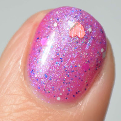 heart glitter nail polish close up swatch