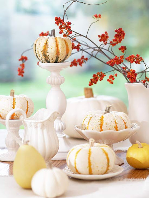 The mini white pumpkins add a fall element to the table and look vintage too.