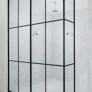 Glass loft partitions for the shower retain the effect of open space