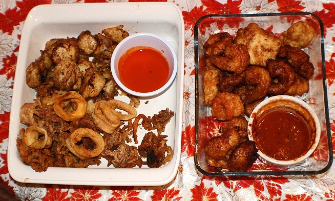 this is fried calamari with hot sauce and other seafood