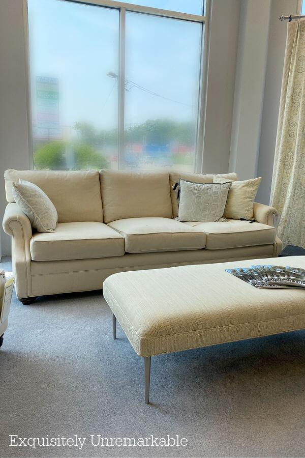 Cream Colored Sofa and Ottoman