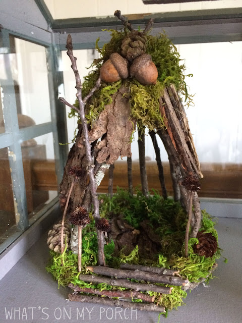 Fairy house with twigs, acorns, moss