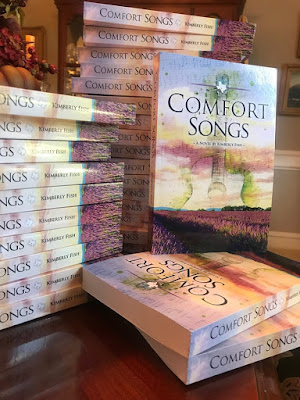 Bookstagram: stacked copies of Comfort Songs