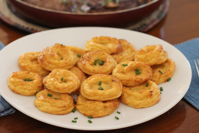 Food Lust People Love: Golden Marquis Potatoes are food fit for royalty. Butter, cream and several rich egg yolks are added to tender mashed potatoes and piped into hollow rosettes, which are then baked till golden. These are the fanciest potatoes that are easy to make.