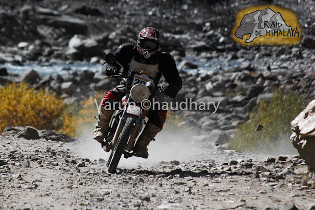 After extreme action of cars at Raid de Himalaya, it's time to have a PHOTO JOURNEY of Bikers. Usually bikes are more interesting to click as compared to cars, but in Raid everything is super exciting !!! Let's start this journey with bikes in action....This whole event is very well planned and everyone is well aware of actions to be happen during the week of Raid. I was really amazed to see the detailing of event at http://www.raid-de-himalaya.com/2011/Xtreme/supregs2w2011.pdf . I have seen documents of other motorsports in North India and most of them are really disorganized and planned very unprofessionally. The whole team of Himalayan Motorsports work really hard to make each thing very special and safe !!!Bikes are really specially for shooting and panning is one of the technique, which can't be missed during such events where bikers love to fly in air...Raid de Himalaya started from Peterhoff Hotel, Shimla and day one ended at Manali through Jalori Pass !!! Whole route was like  Shimla to Manali == Manali-Leh(via Sarchu) ==Leh-Leh(via Wari La & Khardung La) == Leh-Rangdum(via Kargil) == Rangdum-Rangdum(via Padum) == Rangdum-Srinagar(via Kargil)Himalayan Motorsports organize this wonderful event and here are some contact details -Himalayan MotorsportMotoworld, Navbahar, Shimla,Himachal Pradesh - IndiaPhone: +91 (0) 177 2842916Fax: +91 (0) 177 2844338Email: info@raid-de-himalaya.comTotal distance covered was 2200 kilometers, including 667 kilometers of competitive sections. 667 Kms were covered during 11 different competitive stages. The Moto Alpine was about running the first 3 legs of the rally and end at night haltof leg 3 at Leh. This shorter version was open to all newcomers to the Raid de HimalayaOnly those that had never participated before in the Raid (on a / Quad) are eligible tenter for the Moto Alpine.The Moto Xtreme was complete version of the Raid de Himalaya, running all 6 legs anwas open to both previous participants as well as the new entrants to the Raid, In shorwhereas a previous participant could not enter the Moto Alpine...Bikes of 100cc to 700cc participate in Raid and all of them are categorized into different classes, on the basis of their machine powers.Most of these folks used some imported bikes or modified versions of high power bikes. On top of that each biker needs to have a team to ensure that any break-down on the way can be fixed as quick as possible.Another special thing about these motorsport rallies is their route. Most difficult terrain are chosen with appropriate safely measures in mind. In fact, security planning takes various months to finalize things with Government and private agencies. All riders in Raid are really disciplined about safely as well. Following passion with proper safely measures is also very important.Raid de Himalaya rally passes through various villages in Himachal Pradesh and Jammu & Kashmir !!!Riding on such a road is a real luxury. At various points it's difficult to find the road on rough hills with landslides and water streams around !!! Riding bike in Raid is really difficult as riders have no option of driving the vehicles by sitting on closed cabins. Weather is another challenge for bike riders in Raid de HimalayaSome information picked from official Facebook page of RAID DE HIMALAYA Raid de Himalaya is among the most extreme motor sport events organized at an international level. It runs on the highest altitudes as compared to others including the Paris Dakar Rally. http://www.raid-de-himalaya.com/Mountains and Bikes seem to be made to be seen together. Several Indian travellers have now started taking on the mountains on their bikes. The main reason is the same as the the bikers participating in the rally - the thrill of scaling these heights.Navigating the curves, dodging the rocks, and leaving a dust trail, the riders manoever their mean machines faultlessly and spectators can't do much but stare at them with awe.They look the same at a glance, but all riders have their own unique techniques that only experts can detect.Amongst the barren, brown hills the only streaks of colour are these motorbikes. For the duration of the rally, the region comes alive with these dashing, roaring machines.In spite of the tiring route that not only makes you push the boundaries of your schools, each biker starts longing to return for another ride, another adventure soon after one is over.Rearing and roaring like a wild beast, these bikes are merely pets in their riders' hands, obeying each command, following each direction to the last letter.Once the race is over and the bikers have left, the hills lie forlorn, full of longing for these noisy destructive forces of technology to come and make them come alive again.The heights seem scalable and the terrain no longer a foe, when you are flying on your machine. No wonder each biker comes back year after year to scale these heights till they become as familiar to them as the back of their hands.
