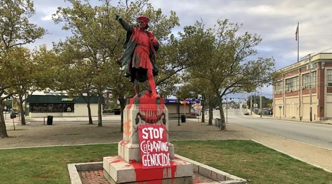 """Con el mensaje """"paren de alabar al genocida"""" tiñen de rojo estatua de Colón en Providence"""