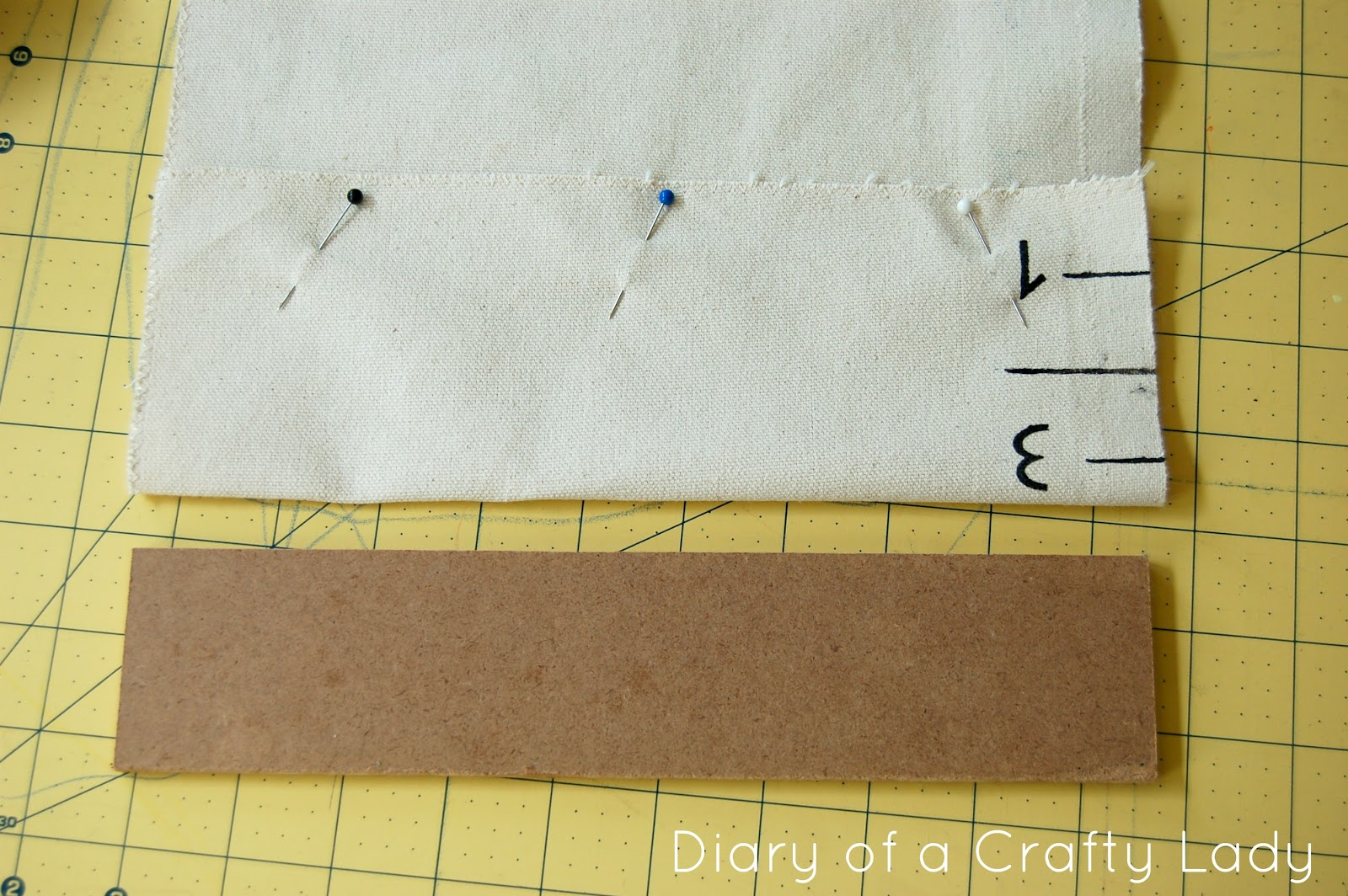 Diary of a crafty lady diy canvas growth chart i cut of the excess fabric from the top i decided i wanted mine barely over 6 tall and then sewed the top under to make a smaller loop geenschuldenfo Images