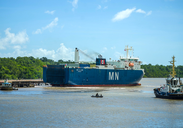 Carrying NASA's James Webb Space Telescope within her cargo hold, the French vessel MN Colibri docks at French Guiana's Port de Pariacabo in South America...on October 12, 2021.