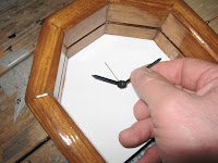 Attaching the hands of the clock
