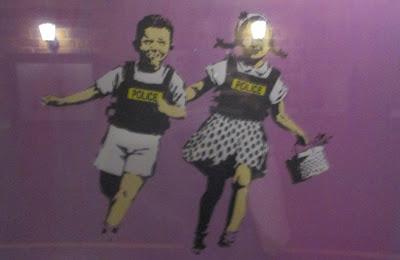 http://www.stencilrevolution.com/photopost/2013/05/Police-Kids-Jack-And-Jill-by-Banksy.jpg
