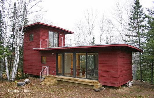 Casa prefabricada moderna compacta con terraza