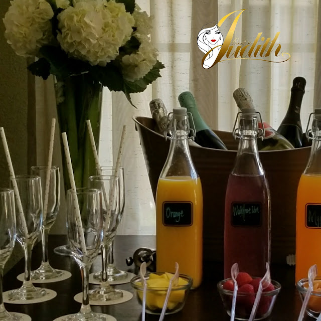 champagne flutes, fruits, paper straws, floral centerpieces, mimosa