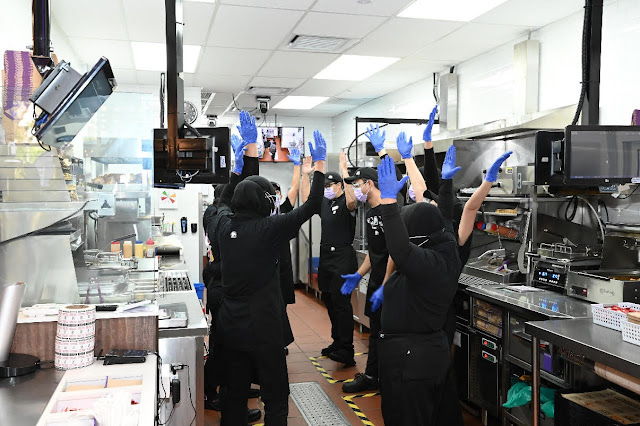 Taco Bell Malaysia's team members getting ready to greet customers for the first time