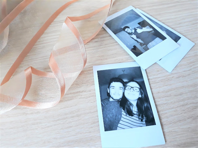 Couple in Polaroid Image with ribbon.