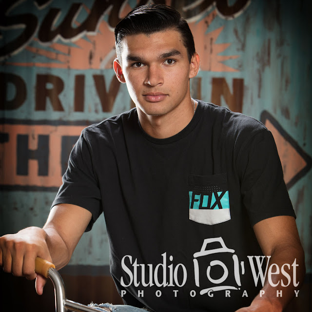 High School Senior Portrait - Studio Portrait - Rustic Ghost Sign Background - Studio 101 West Photography