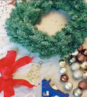 Supplies needed for making a DIY handmade holiday wreath.