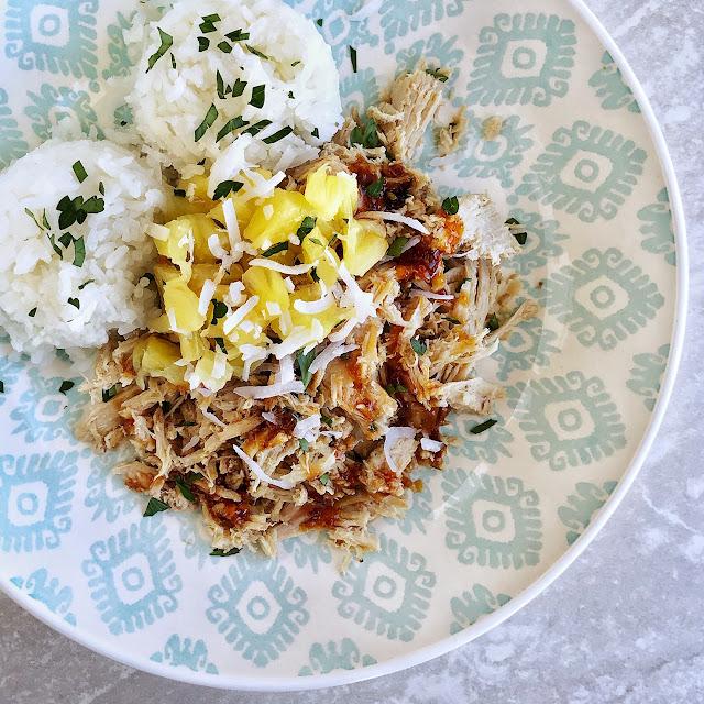 hawaiian kalua pork with rice and pineapple and sauce