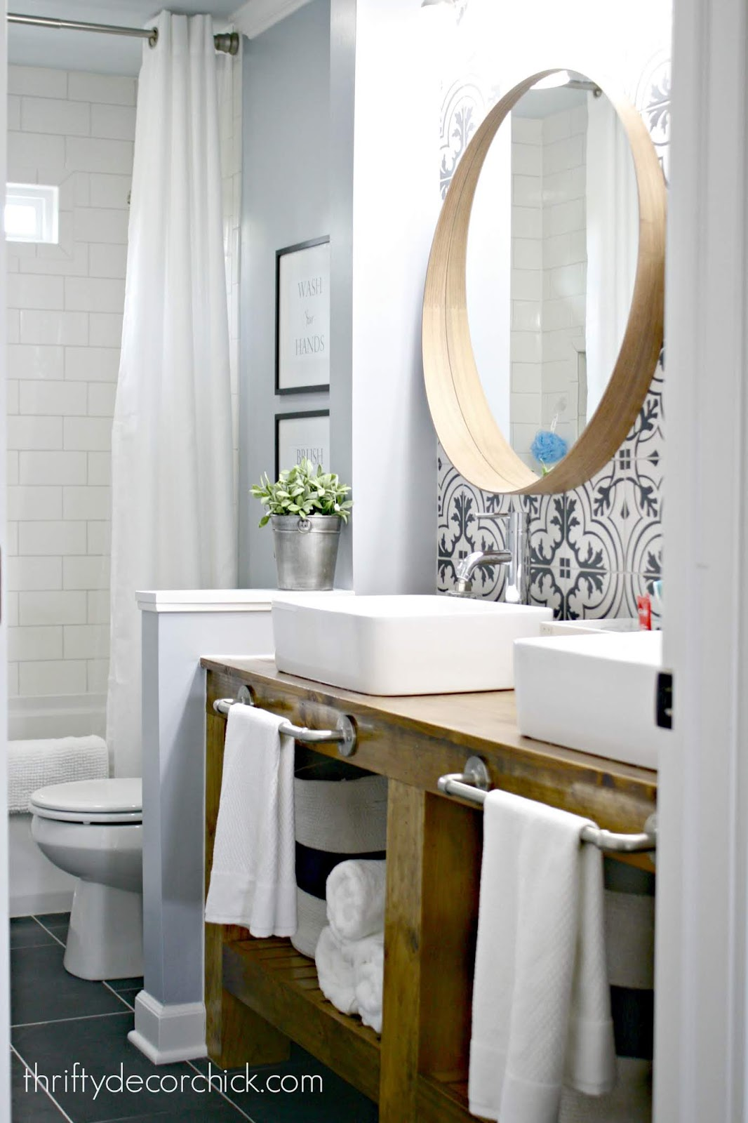 Modern farmhouse bathroom with tile and open vanity