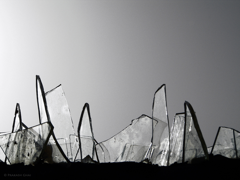 A Minimalist Photo of broken glass wall fence