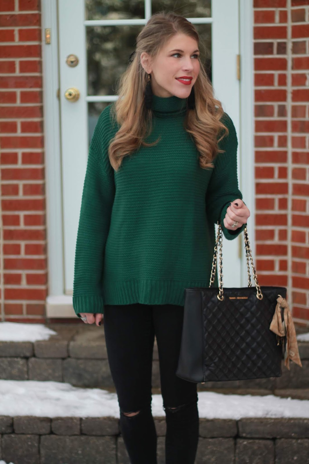 green turtleneck sweater, distressed black jeans, Steve madden black booties, black leather quilted tote,