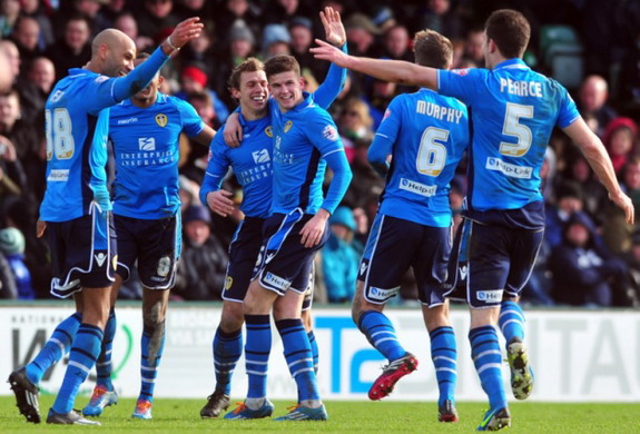 Stephen Warnock celebrates with Leeds teammates after scoring the winning goal against Yeovil