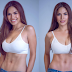 Andrea Torres is showing off her toned abs after Derek Ramsay split