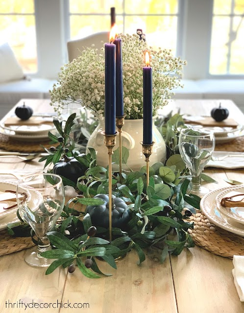 brass candlesticks blue candles tablescape