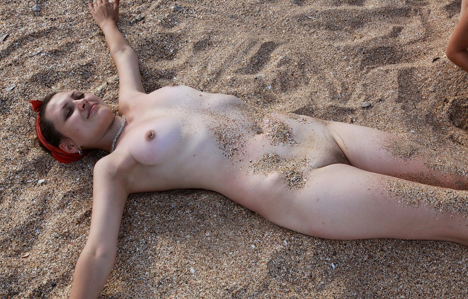 Nude beach family body art