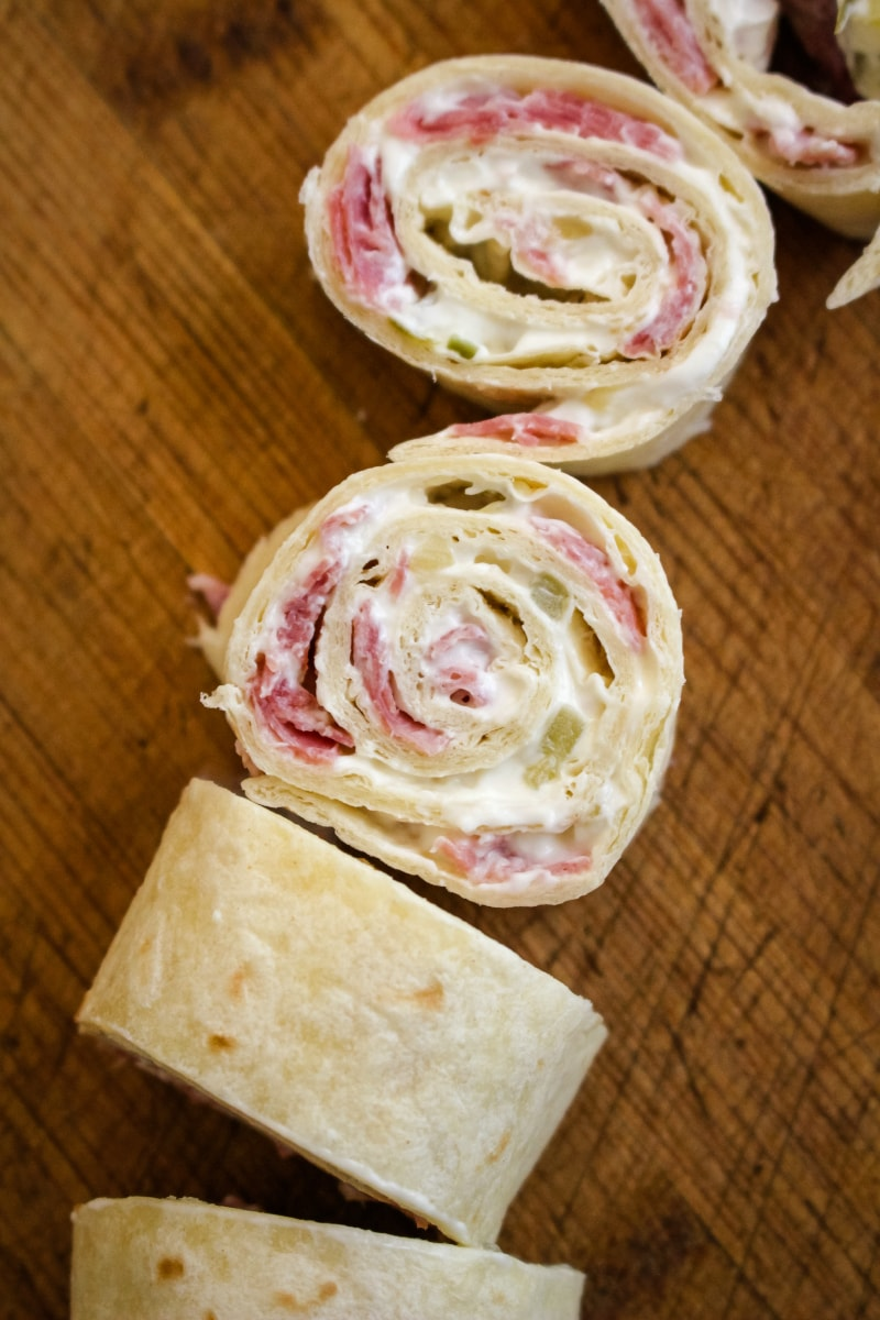 Salami Pinwheels are easy to make with just four simple ingredients! They make a fun and tasty snack, lunch, or party food. #salami #appetizer #fingerfood